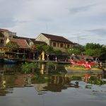 Tourists Explore UNESCO Old Town Hoi An From River
